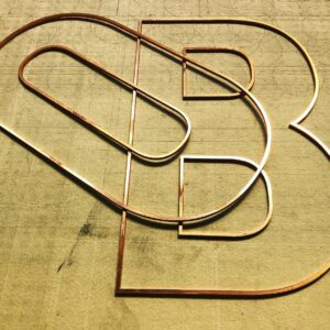 Burmak AG Wasserstrahlschneiden Schriften Logos Werbetechnik