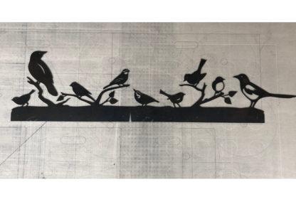 Vogel Silhouette aus Metall wasserstrahlgeschnitten